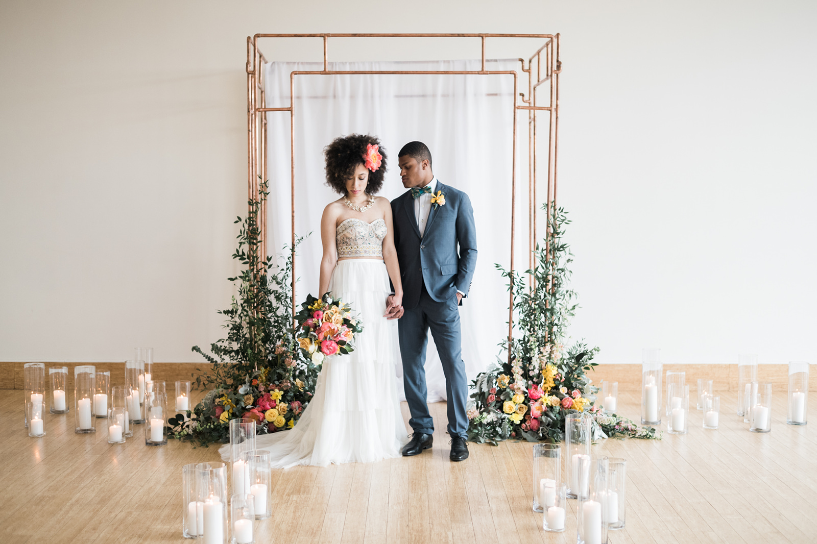 Copper Ceremony Arch with boho floral design at Phipps Conservatory in Pittsburgh.