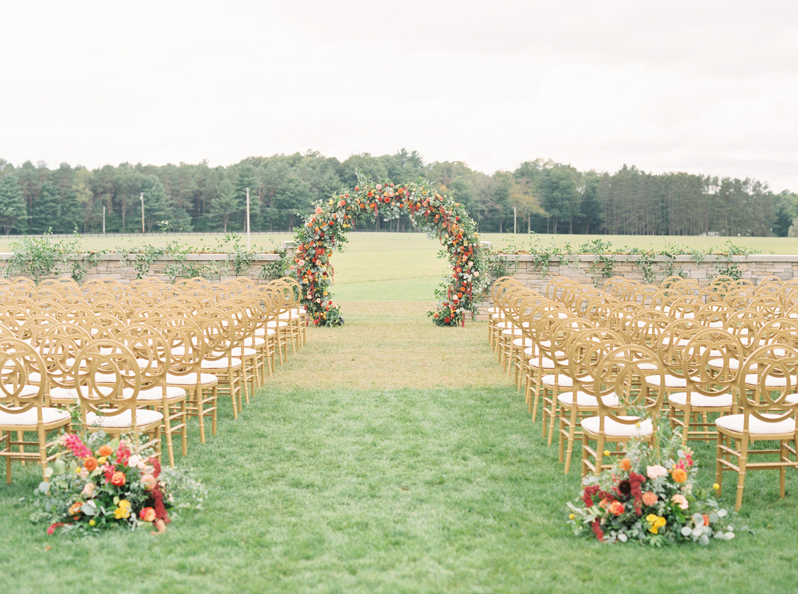 outdoor ceremony arch floral wedding decor